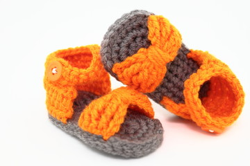 A Pair Of Handcrafted Baby Sandals In Orange And Gray