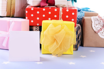 Pile of colorful gifts on blue background with stars