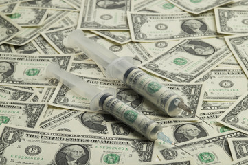 Syringe and dollar-bill