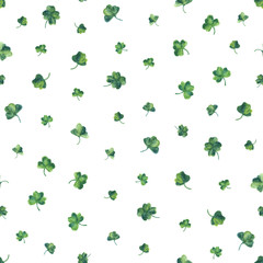 Seamless watercolor background with green clover leaves for