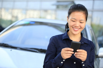 young asian business woman use digital tablet outside modern off
