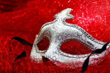 Wall Mural - Vintage carnival mask in red background