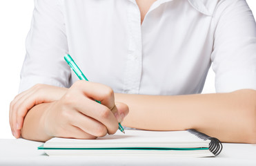 Close up Business woman writing on notebook with pen.