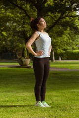 Side view of healthy woman standing in park