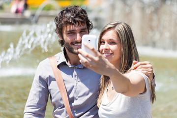 Couple taking a selfie portrait