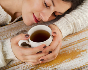 Relaxing young  girl with cup of tea