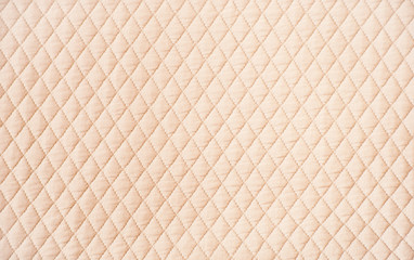 Beige quilted pattern background
