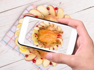 Hands taking photo chicken with smartphone