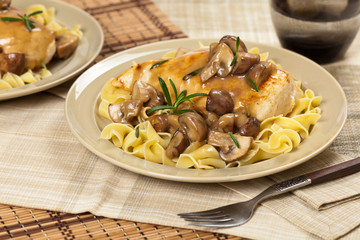 Chicken Marsala with Mushrooms and pasta. Selective focus