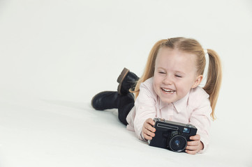 Smiling and having fun the photographer a beautiful blond girl o