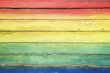 Rainbow Colors Painted on Weathered Wood