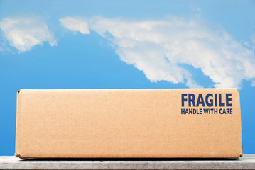 Shipping box with fragile handle with care as notice against blu