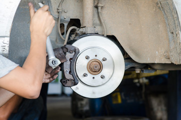 brake disc with technician hands