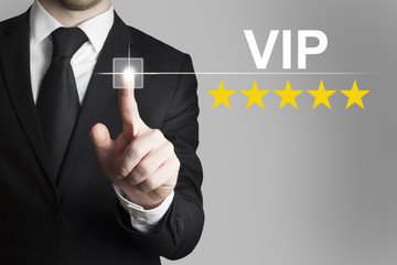 businessman pushing button vip stars