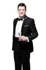 New year's eve fashion man wearing black dinner jacket. Holding
