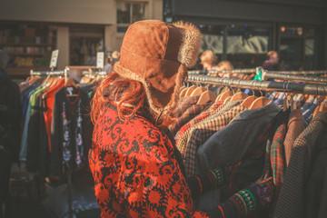 Woman browsing jackets at market