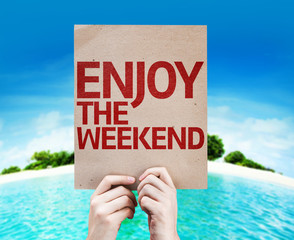 Enjoy The Weekend card with a beach on background