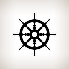Silhouette ship wheel  on a light background