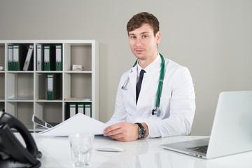 doctor with a medecine documentation smiles