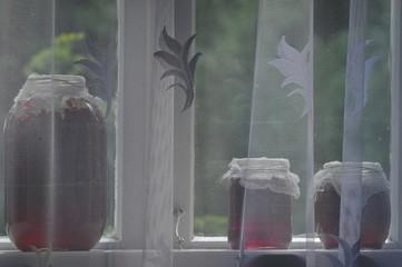 Jar, jars of jam with red currants on the windowsill, farmhouse