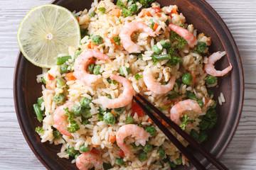 Asian fried rice with seafood closeup, horizontal top view