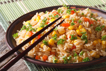 Chinese fried rice with eggs, corn and spices,  horizontal
