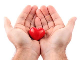 Red heart in male hands.