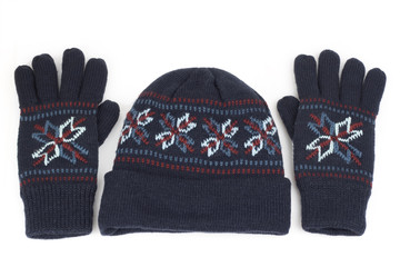 cap and gloves perfect for winter time isolated on white
