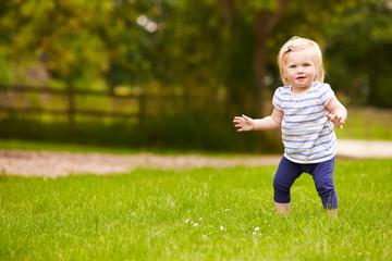 Young Girl Having Fun Playing Game Outdoors