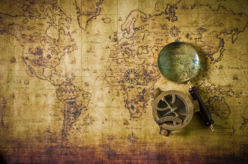 Foto op Canvas Wereldkaart old map with compass and Magnifier