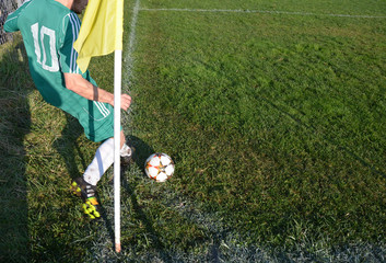 corner shoot , player , flag, green lawn  lines football soccer