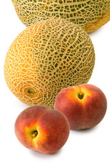 Isolated image of peach and melon on a white background