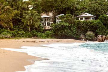 beach at sunset, palms and Resort