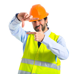 Worker focusing with his fingers
