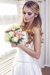 beautiful bride in elegant dress with wedding bouquet
