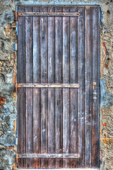 wooden door in a rustic wall