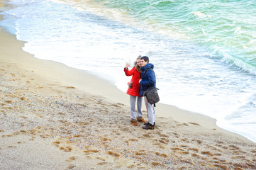 Woman and man  taking photo with smart phone camera.