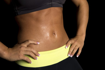 woman workout stomach close hands on hips