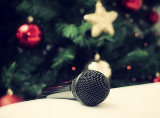 Black microphone with christmas tree