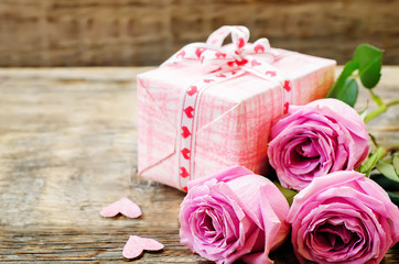 Valentine's background with gift and flowers