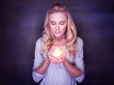 Attractive woman with candle