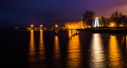 Concord Point Lighthouse and a pier at night in Havre de Grace,