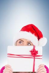 Festive blonde holding christmas gift