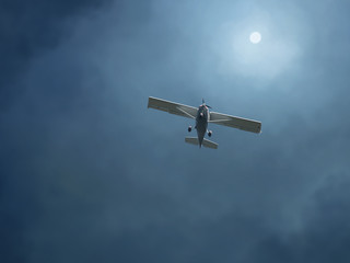 Fototapete - airplane in a stormy sky