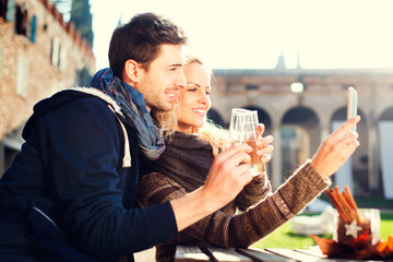 couple gets a Selfie while drinking aperitif