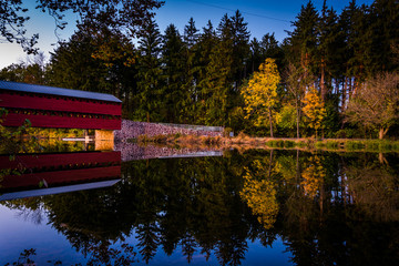 Sach's Covered Bridge reflecting in Marsh Creek at twilight, nea