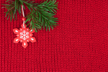Christmas background of red wool knitted fabric with decoration