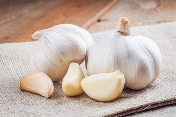 Organic garlic whole and cloves on the wooden background Wall mural