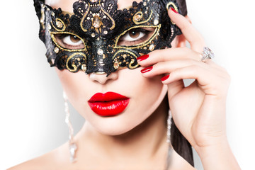 Wall Mural - Beauty model woman wearing masquerade carnival mask
