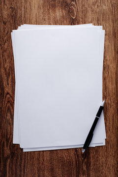 White Blank Papers and Pen on Wooden Table